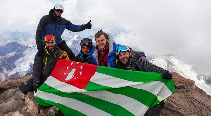 National Flag of Abkhazia Planted on the Summit of Aconcagua