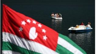 Russian tourists enjoy summer holidays by Lake Ritsa in